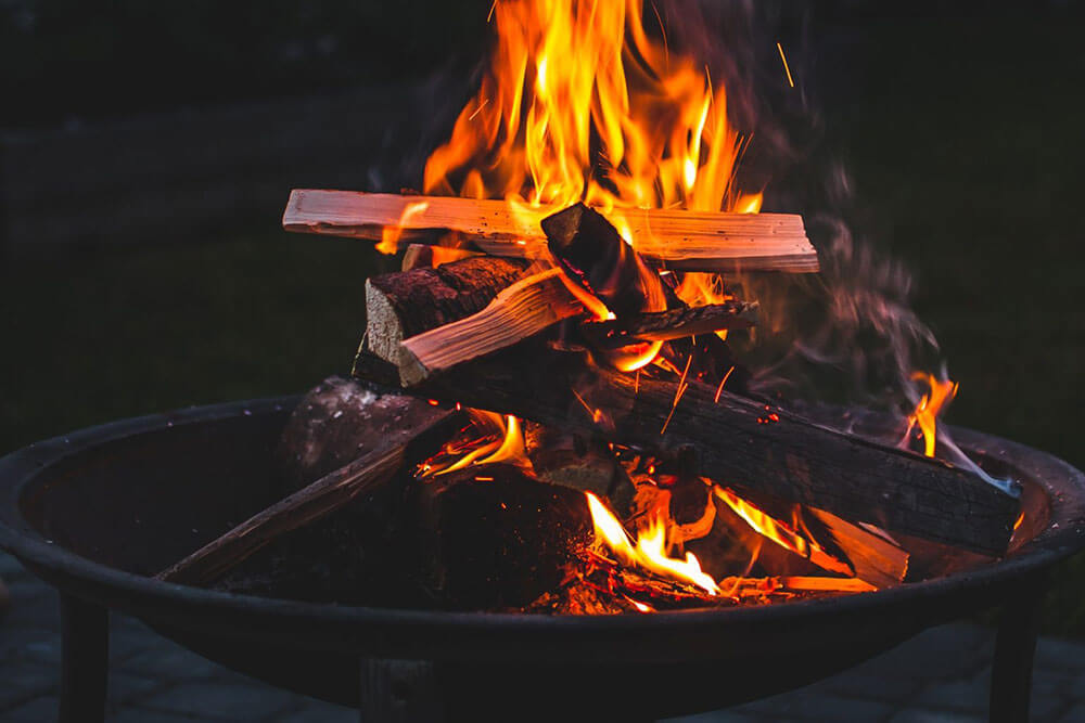 Firepit with logs burning