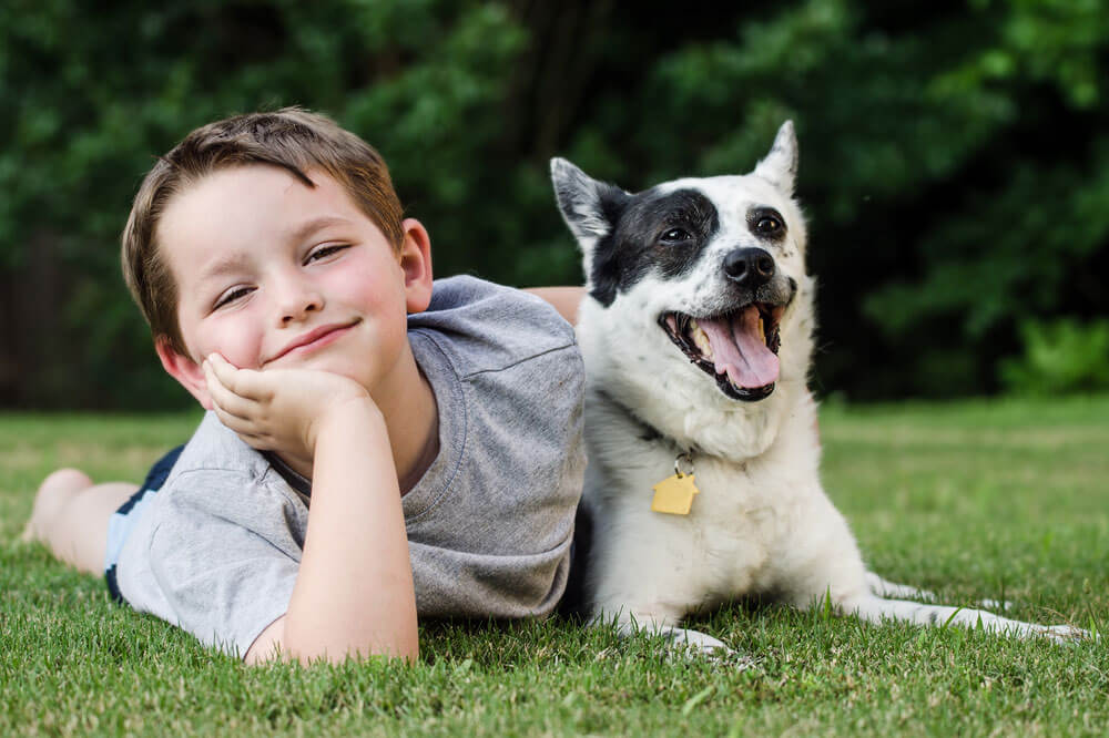 A boy and dog smiling