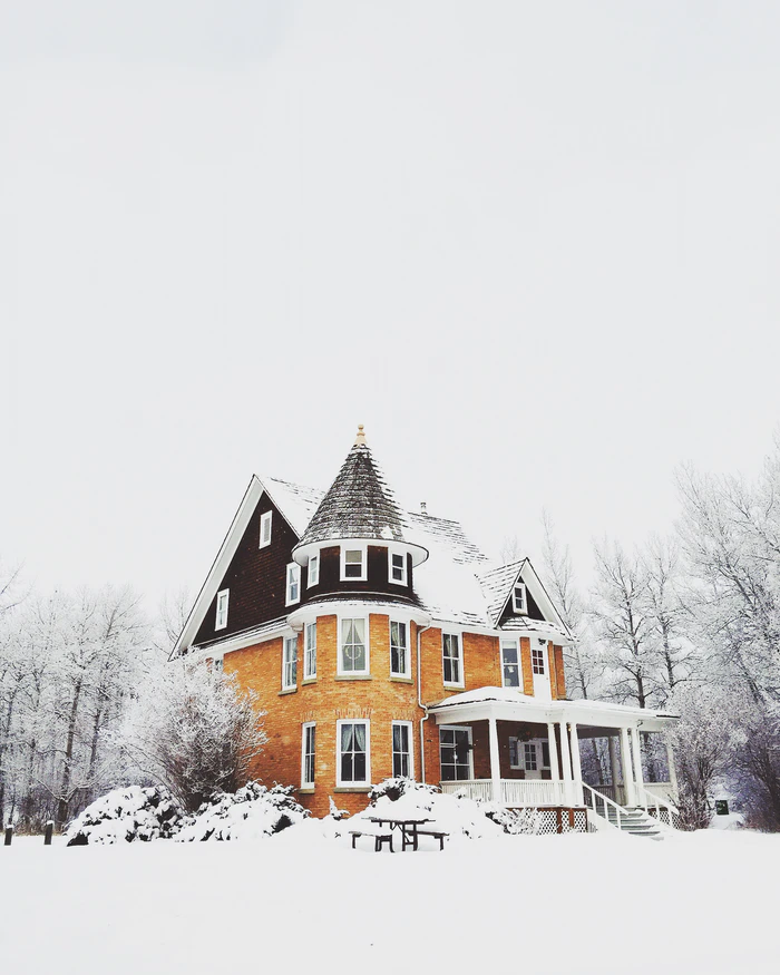 House freshly coated in snow